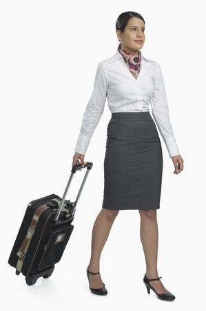 pull out: Air hostess carrying her luggage