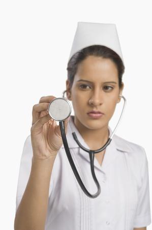 Female nurse holding a stethoscope Stock Photo - 10123947