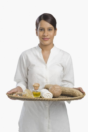 Woman holding a tray of products for aromatherapy Stock Photo - 10124214