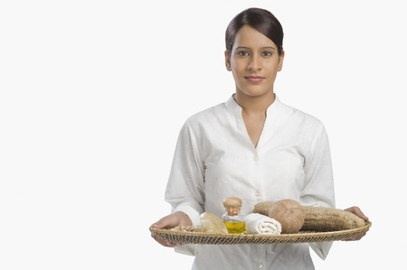 Woman holding a tray of products for aromatherapy Stock Photo - 10123967