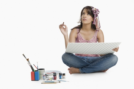 Woman painting a picture and thinking Stock Photo - 10125662