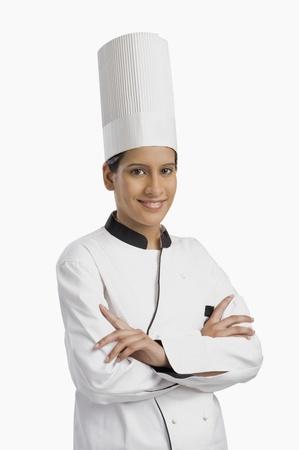 Portret van een vrouwelijke chef-kok glimlachen