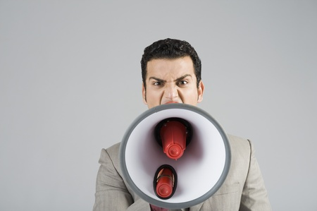 Businessman shouting into a megaphone Stock Photo - 10125223