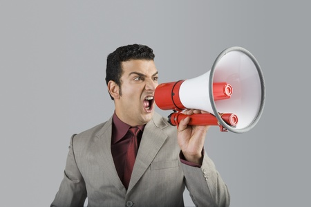 Businessman shouting into a megaphone Stock Photo - 10124720