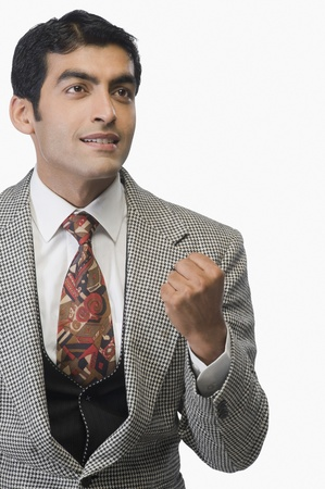 clenching: Businessman clenching fist LANG_EVOIMAGES