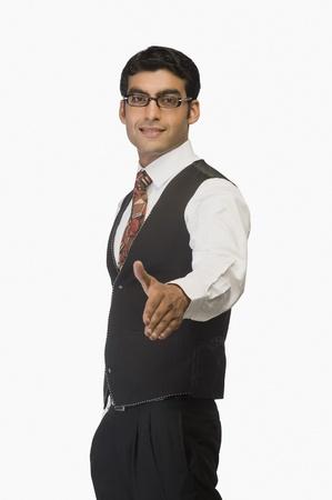 Businessman offering a handshake Banco de Imagens