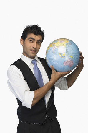 world at your fingertips: Businessman showing a globe