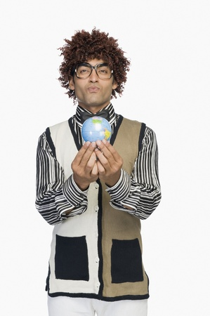 world at your fingertips: Portrait of a man holding a globe LANG_EVOIMAGES