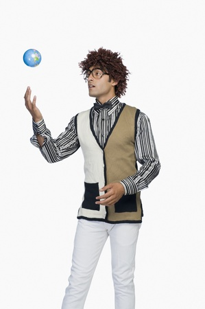 world at your fingertips: Man tossing a globe