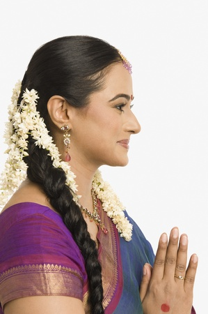 gajra: Woman making a greeting gesture and smiling