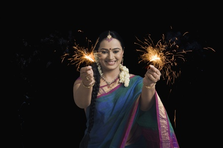 Woman celebrating Diwali festival with sparklers Stock Photo - 10124183