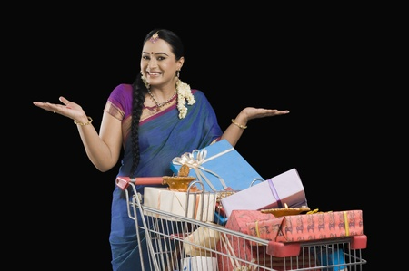 Woman carrying Diwali gifts in a shopping cart Stock Photo - 10125497