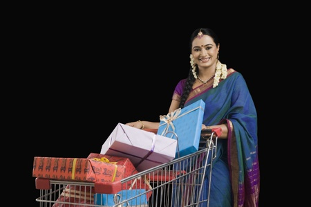 Woman carrying Diwali gifts in a shopping cart Stock Photo - 10125610