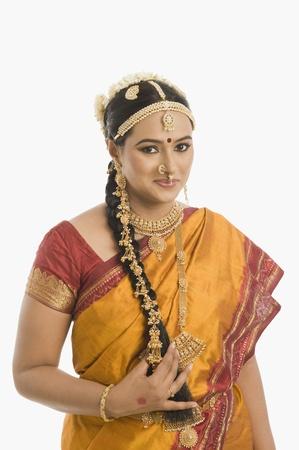 gajra: South Indian woman smiling LANG_EVOIMAGES