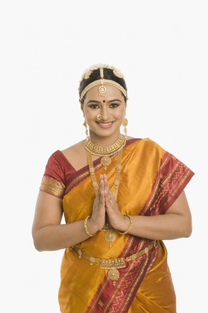 patti: South Indian woman greeting with folded hands