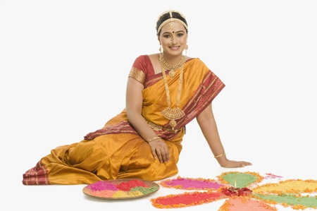 South Indian woman making rangoli Stock Photo - 10166361