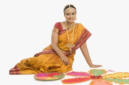 South Indian woman making rangoli Stock Photo - 10166361