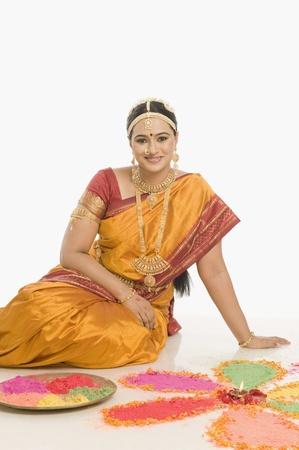 patti: South Indian woman making rangoli