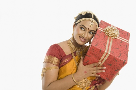 patti: South Indian woman holding a gift box