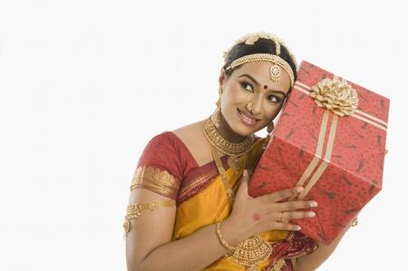 patti: South Indian woman holding a gift box