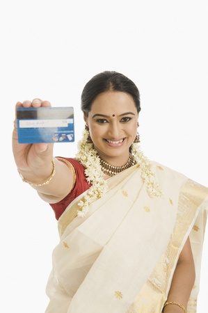gajra: Woman showing a credit card and smiling