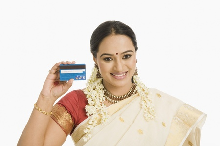 Woman showing a credit card and smiling