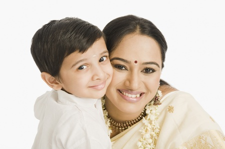 Portrait of a woman smiling with her son