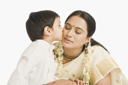 Boy kissing his mother Stock Photo