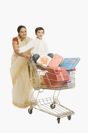 woman shopping cart: Woman and her son with a shopping cart