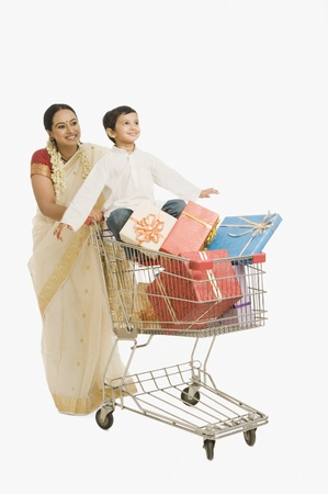 Woman and her son with a shopping cart Stock Photo - 10125130