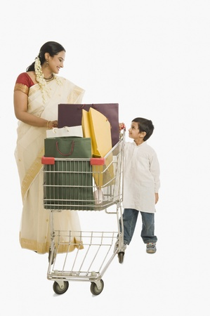 gajra: Woman and her son with a shopping cart