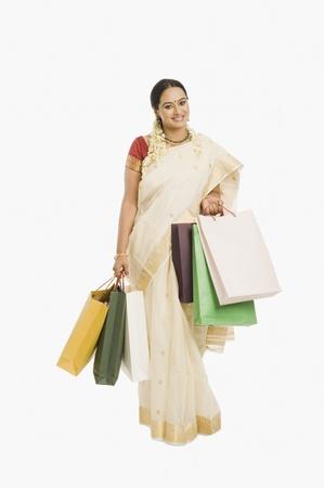 Žena drží nákupní tašky Reklamní fotografie - 10123915