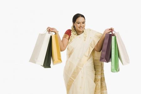 gajra: Woman holding shopping bags