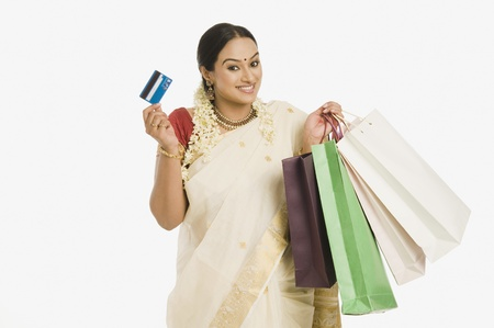 gajra: Woman holding shopping bags and a credit card LANG_EVOIMAGES