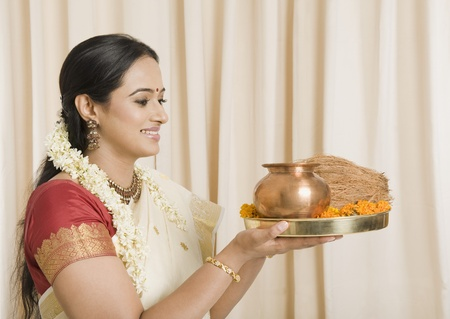 pooja: South Indian woman holding pooja thali
