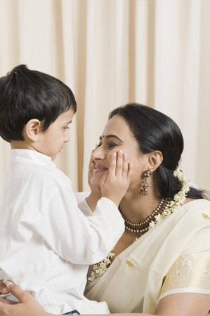 gajra: Woman loving with her son at home LANG_EVOIMAGES
