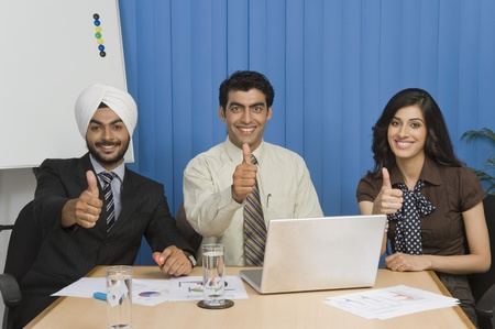 Business executives showing thumbs up and smiling Stock Photo - 10166313