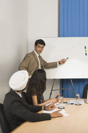 Businessman giving presentation in a conference room Stock Photo - 10125192