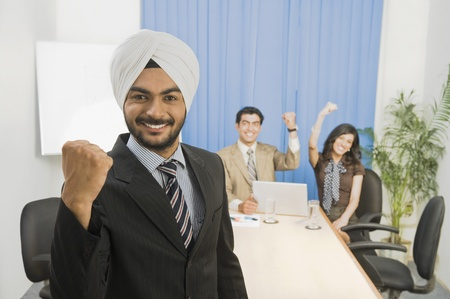 Business executives showing fist and smiling Stock Photo - 10166239