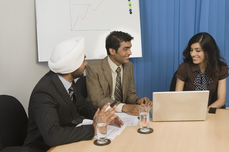 Business executives having a meeting in an office Stock Photo - 10166245