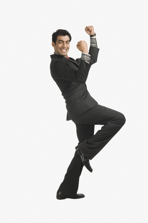 Businessman smiling with his arms raised Stock Photo - 10124174