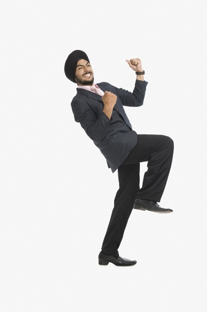turban: Businessman smiling with his arms raised