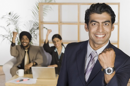 Business executives showing fist and smiling Stock Photo - 10169249