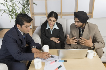 Business executives discussing in a meeting Stock Photo - 10166574