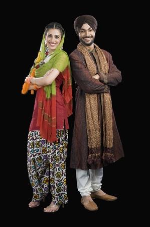 sikhism: Portrait of a Sikh couple smiling LANG_EVOIMAGES