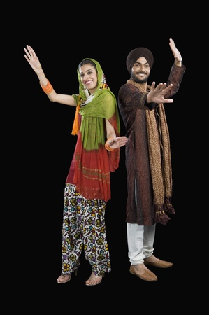 Portrait of a Sikh couple dancing Stock Photo - 10124424