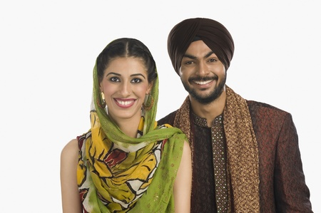 turban: Portrait of a Sikh couple smiling LANG_EVOIMAGES