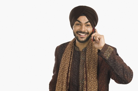 Sikh man talking on a mobile phone