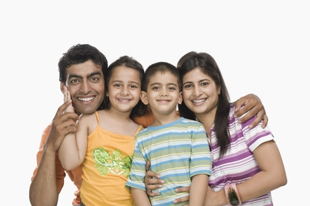 indian subcontinent ethnicity: Portrait of parents with their children smiling