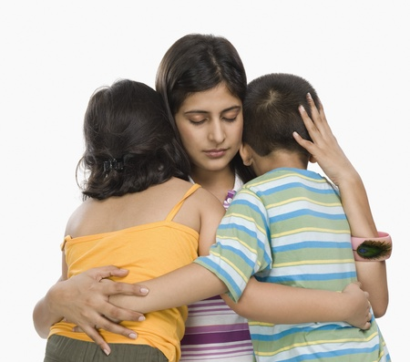 indian subcontinent ethnicity: Close-up of a mother hugging her children
